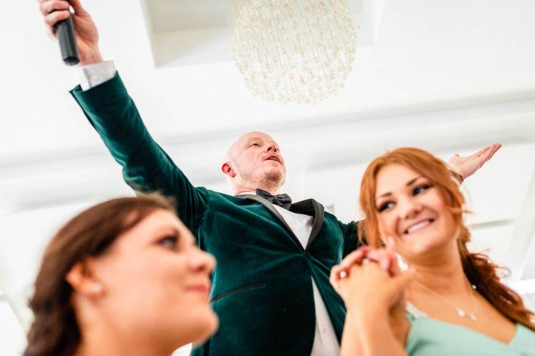 wedding singer raises arms
