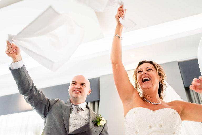 Bride and groom swing napkins
