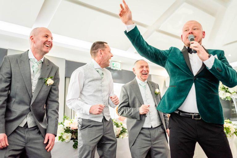 wedding singer has bridal party dancing