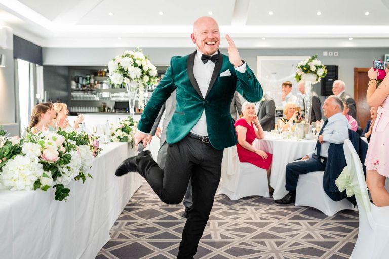 Wedding singer dances around wedding breakfast