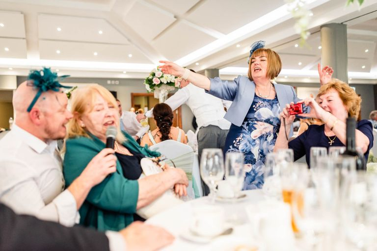 Wedding singer has guests singing along