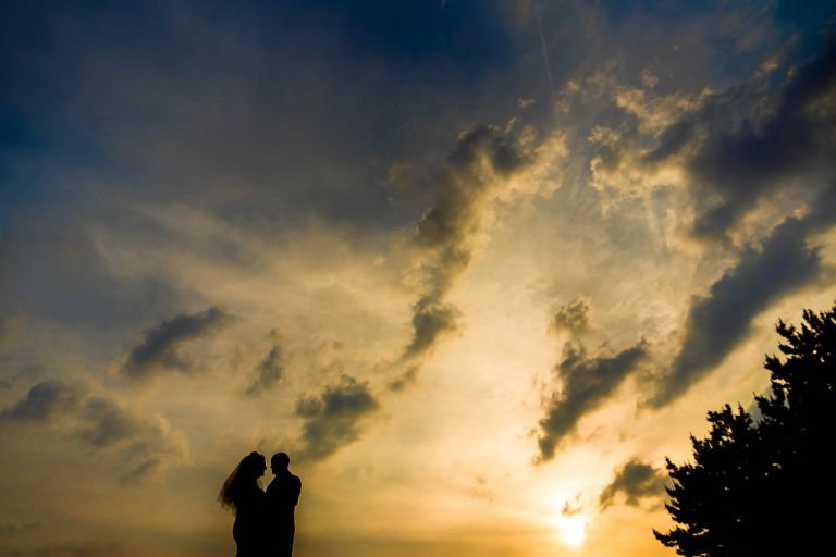 Bride and groom silhouette with sunset