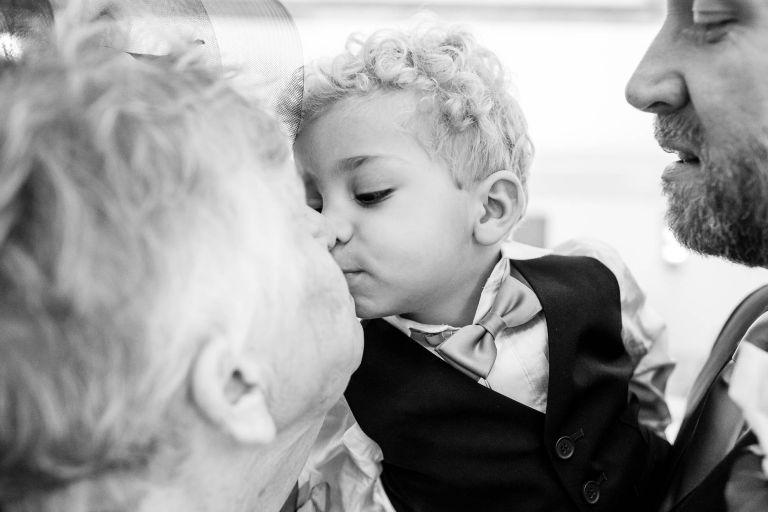 Little boy kisses grandmother
