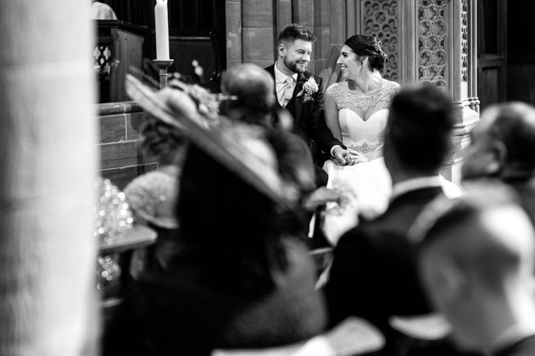 Bride and groom smile at each other during ceremony