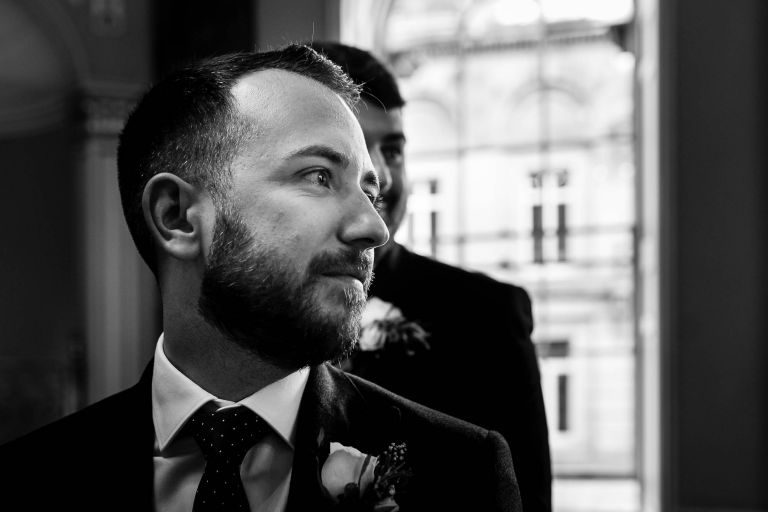 Groom watches his bride walk up the aisle