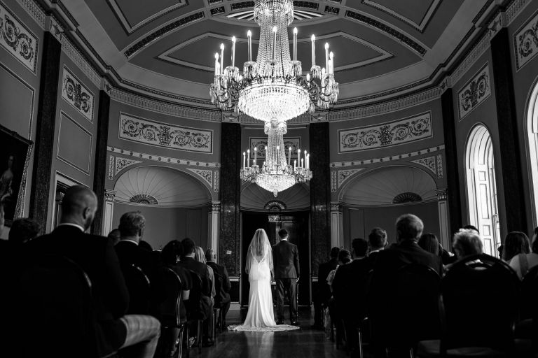 Bride and groom stand together during the wedding ceremony