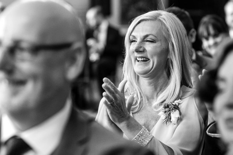 Mother of the bride congratulates the  newlyweds