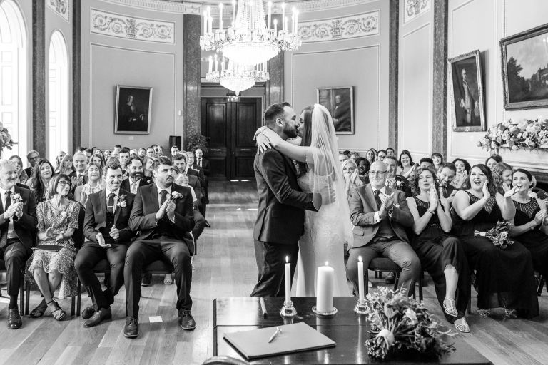 Bride and groom Kiss with the room cheering