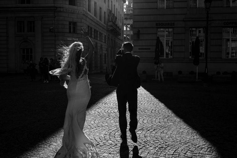 Bride and groom walk into Light
