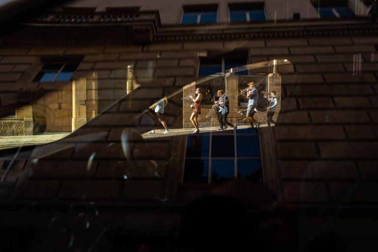 Brass band framed by a car window