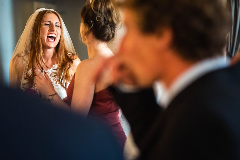 Bride shares a joke with guest