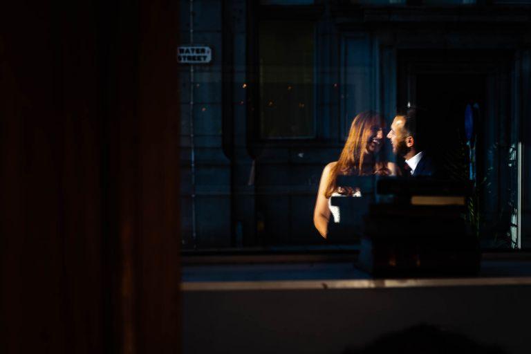 Bride and groom portrait in window
