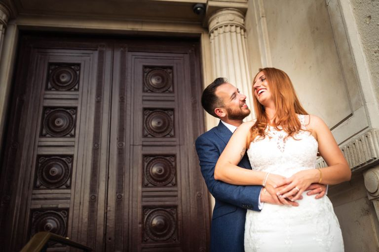 Bride and groom hug each other and are laughing