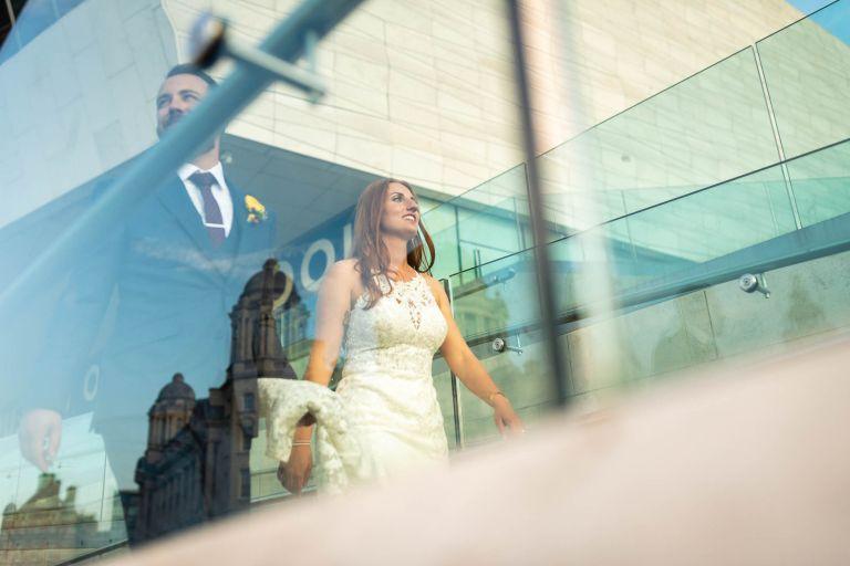 Bride and groom walking past Liverpool Museum