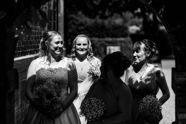 bride shares a joke with her bridesmaids