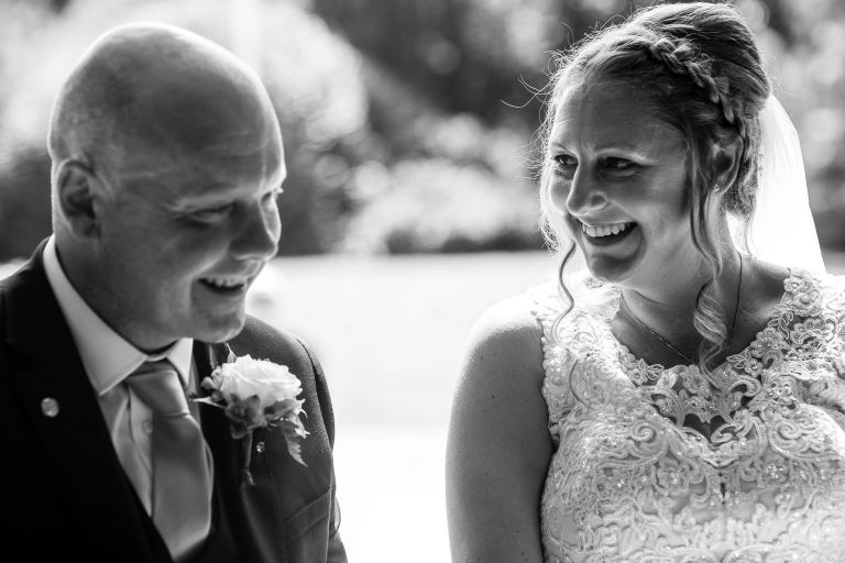 Bride and groom share a joke