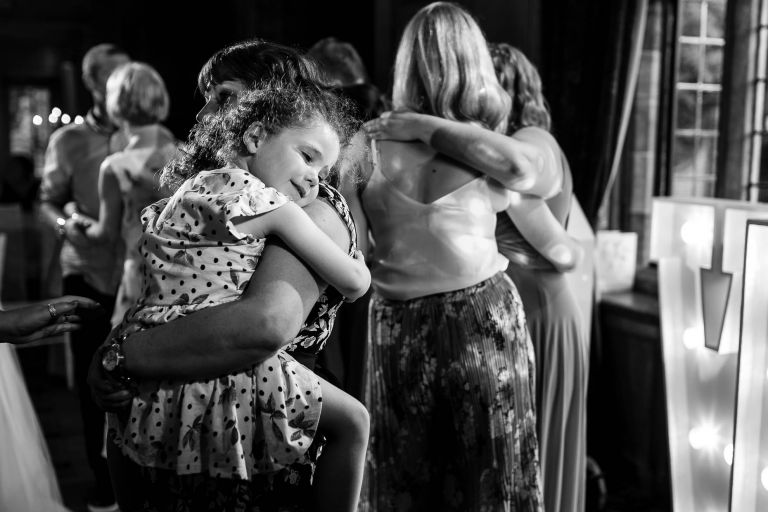 Flower girl enjoying dancing with her mother