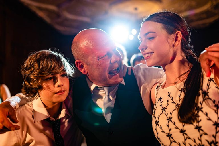 Groom dances with his children