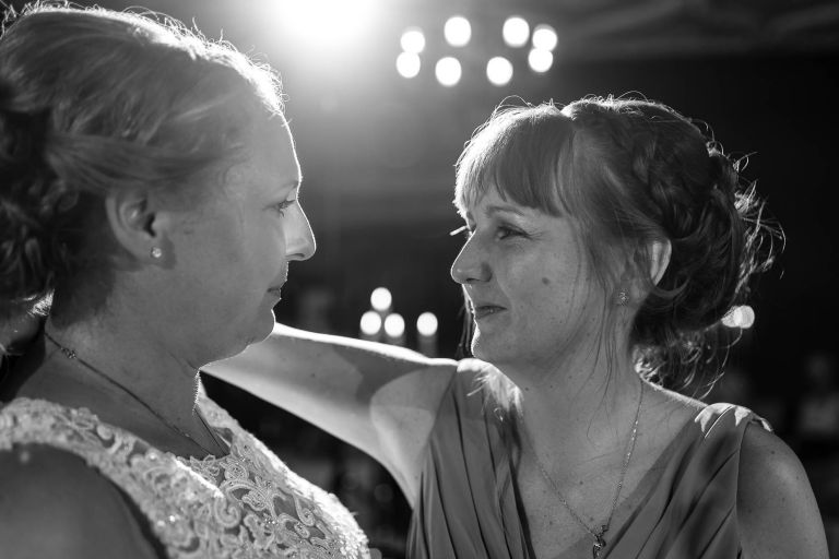 Bridesmaid and Bride share a moment