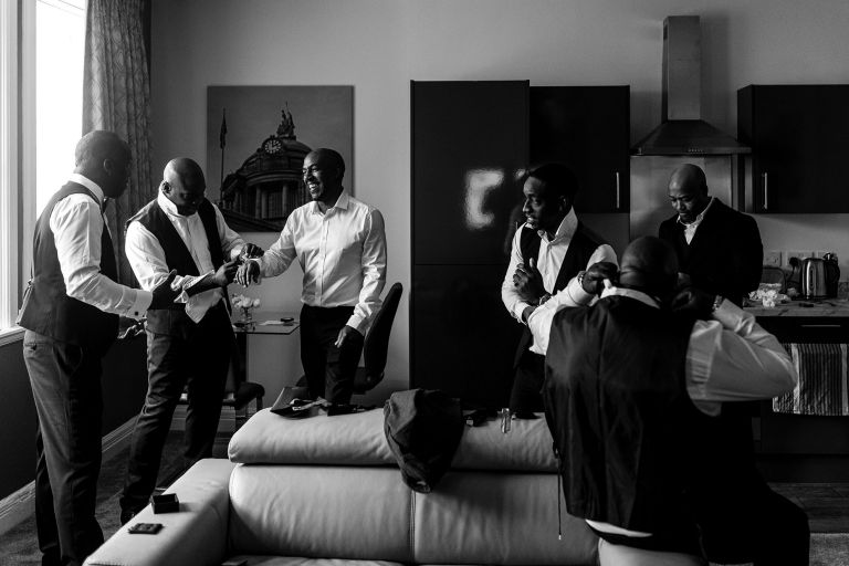 the groom and his groomsmen get ready