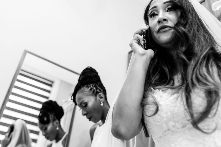 Bride talks on phone