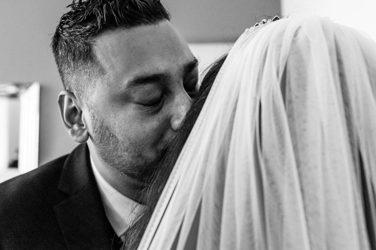 Brides brother gives her a kiss
