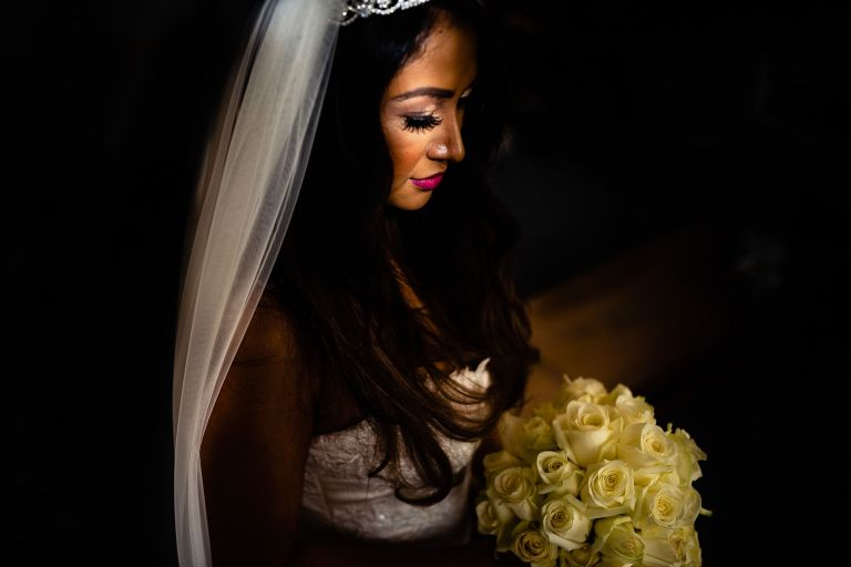 Bride looks at her bouquet