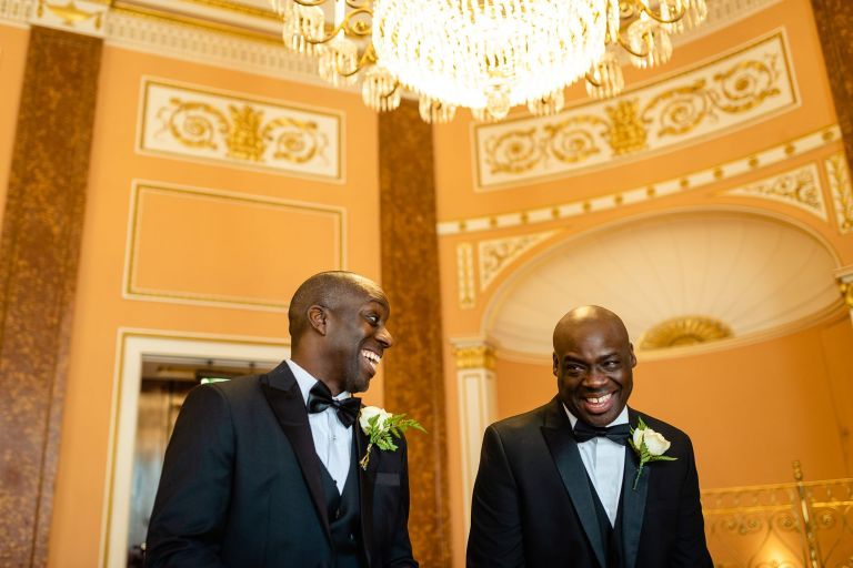 groom shares a joke with his best man
