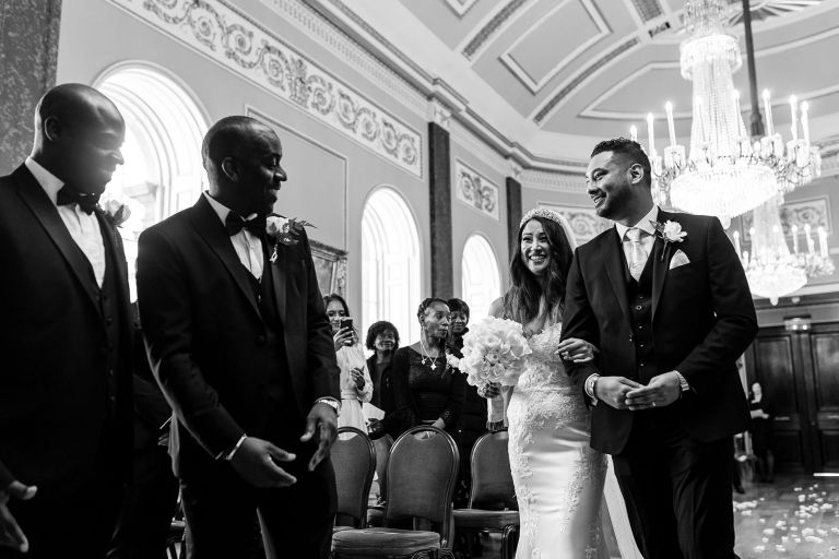 Groom greets his bride as she arrives at the altar