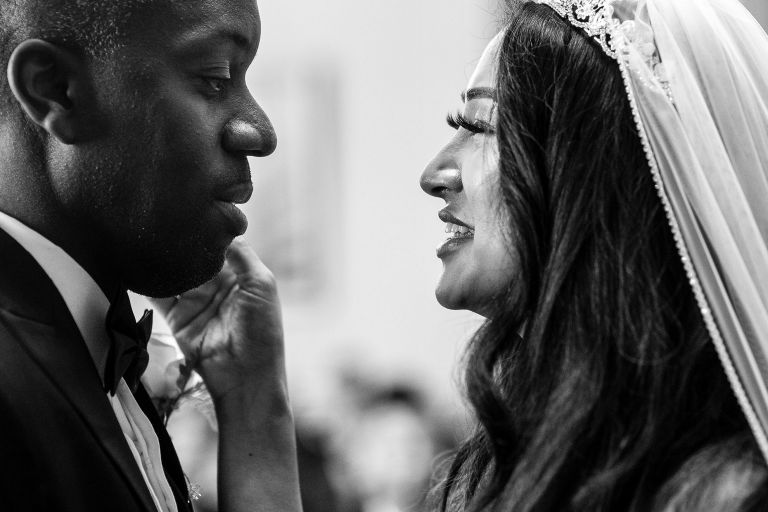Bride and groom look into each others eyes after the wedding ceremony