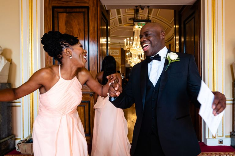 Chief bridesmaid and best man share a joke
