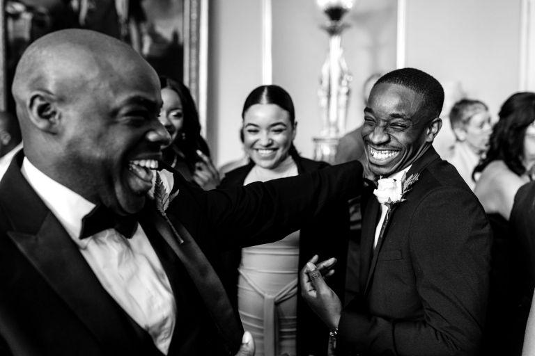 Best man shares a joke with a groomsmen