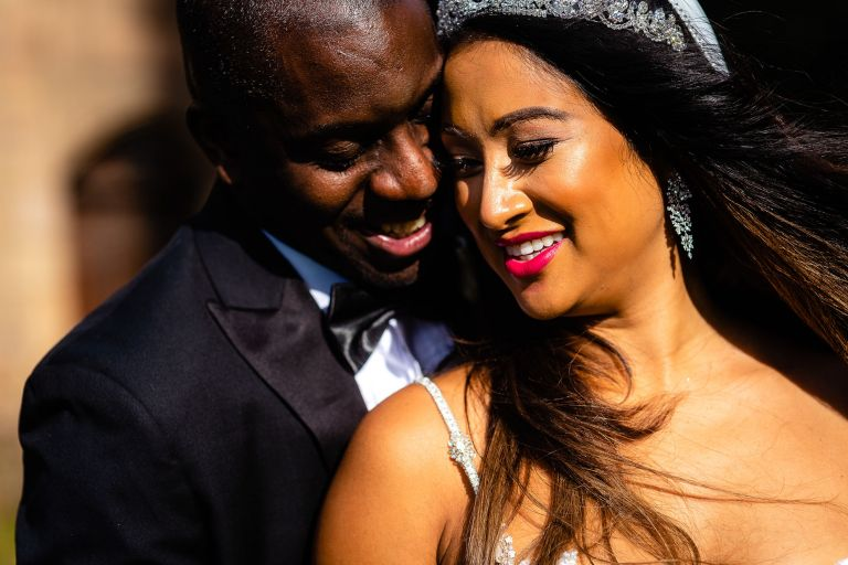 Bride and groom portrait in the sunshine