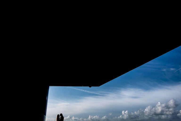 Bride and groom silhouette with sky behind