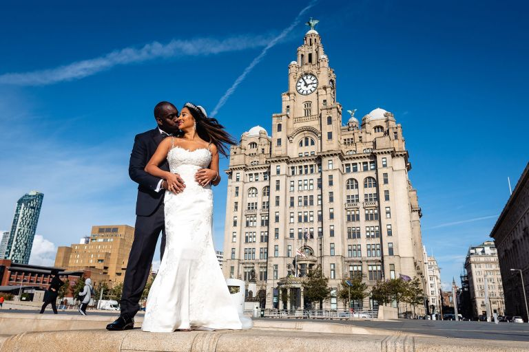Bride and groom portrait in front of Liver building