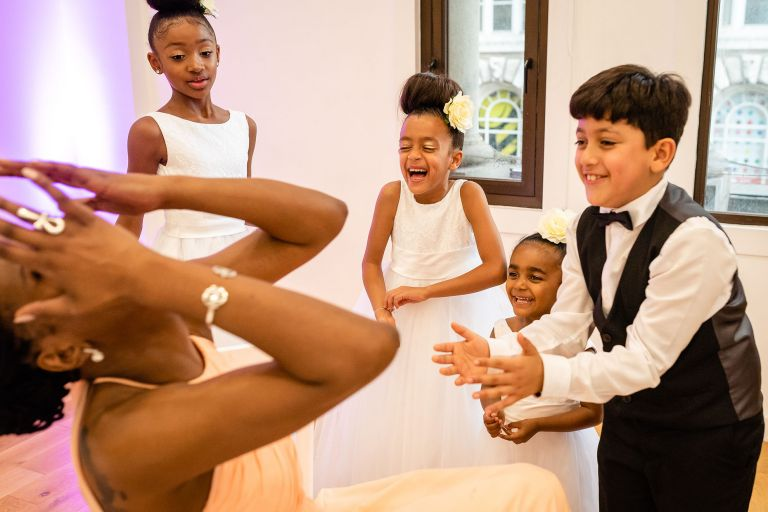 Bridesmaid shares a joke with children