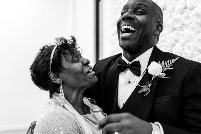 Groom shares a a joke with guest