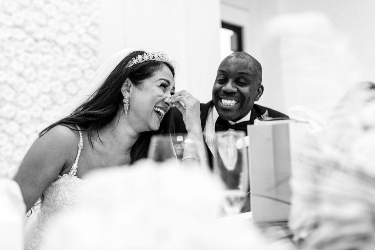 Bride laughs at Chief bridesmaids joke