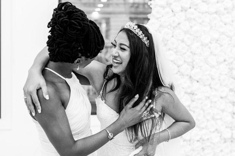 Chief bridesmaid and bride share a joke