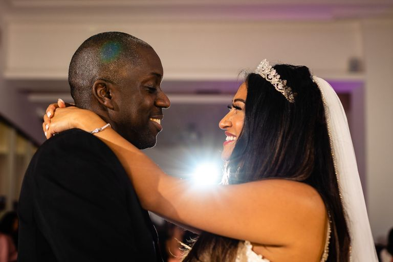 Bride and groom smile during the first dance