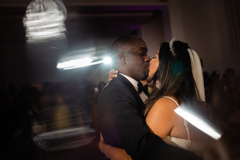 the newlyweds kiss during first dance