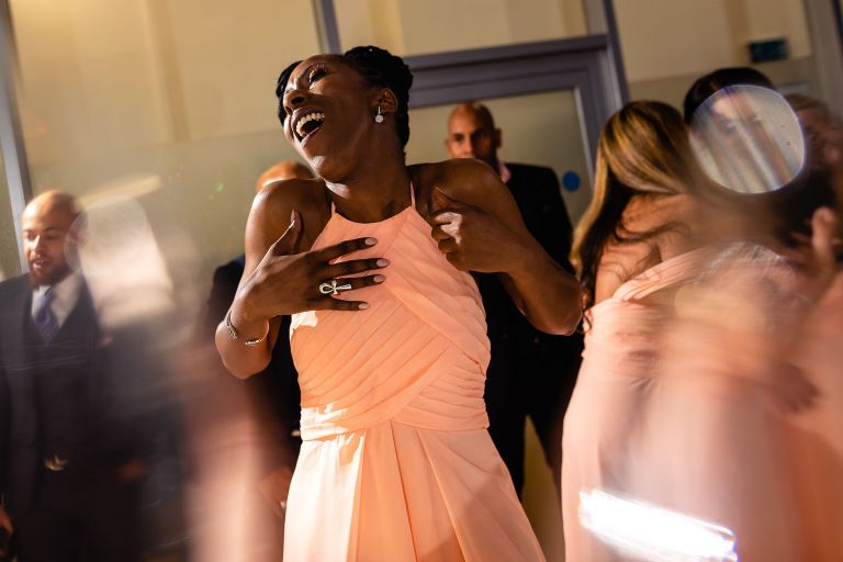 Chief bridesmaid singing as she dances