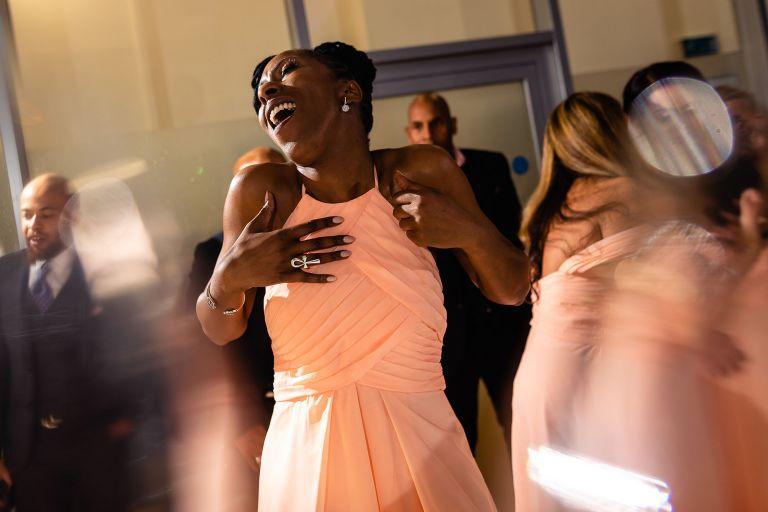 Chief bridesmaid singing as she dances