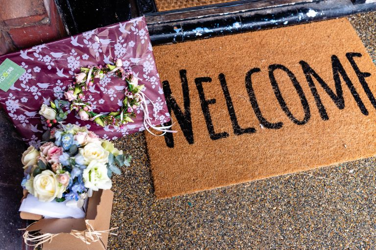 Welcome mat and bridal flowers