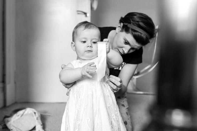 Bride dresses her little girl
