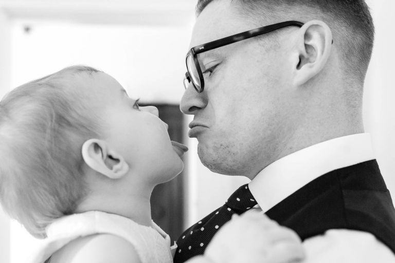 Groom with his little girl