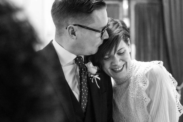 Newlyweds hug and kiss