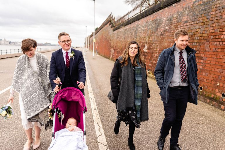 Wedding party walk along Mersey waterfront