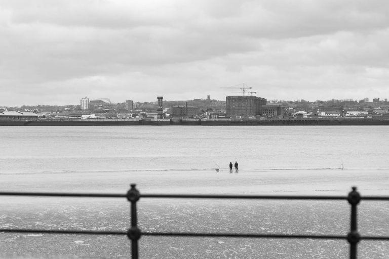 2 men fishing in Mersey river