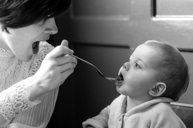 Bride feeds little girl